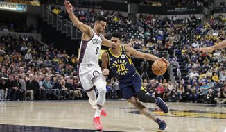 Indiana Pacers guard Jeremy Lamb (26) drives against Brooklyn Nets guard Chris Chiozza (9) during the first half of an NBA basketball game in Indianapolis, Monday, Feb. 10, 2020. (AP Photo/Michael Conroy)