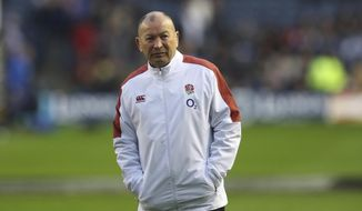 England head coach Eddie Jones stands with his hands in his pockets before the Six Nations rugby union international match between Scotland and England at Murrayfield Stadium, in Edinburgh, Scotland, Saturday, Feb. 8, 2020. (AP Photo/Scott Heppell)