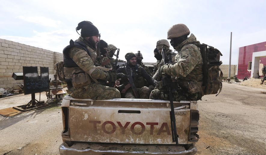 Turkish backed fighter prepare to go to the frontline in the Syrian province of Idlib, Monday, Feb. 10, 2020. The fighting in Idlib led to the collapse of a fragile cease-fire that was brokered by Turkey and Russia in 2018. Turkey supports the Syrian rebels, while Russia has heavily backed the Syrian government's campaign to retake the area which is the last rebel stronghold in Syria. (AP Photo/Ghaith Alsayed)