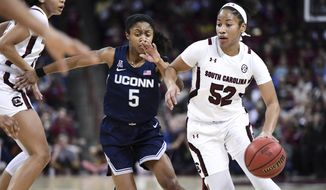 South Carolina guard Tyasha Harris (52) dribbles against Connecticut guard Crystal Dangerfield (5) during the first half of an NCAA college basketball game Monday, Feb. 10, 2020, in Columbia, S.C. (AP Photo/Sean Rayford)