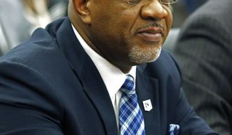 This is a Jan. 16, 2020 photograph of then president of Jackson State University, William Bynum Jr., 57, at a college board meeting in Jackson, Miss. Bynum resigned effective immediately, Monday, Feb. 10, 2020, after he was arrested during the weekend in a prostitution sting in Clinton, Miss. The former president was among more than a dozen people arrested during the weekend. He is charged with procuring services of a prostitute, false statement of identity and simple possession of marijuana. (AP Photo/Rogelio V. Solis)