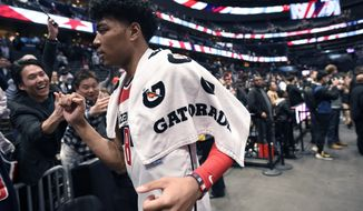 Washington Wizards forward Rui Hachimura (8), of Japan, greets fans after an NBA basketball game against the Chicago Bulls, Tuesday, Feb. 11, 2020, in Washington. The Wizards won 126-114. (AP Photo/Nick Wass)
