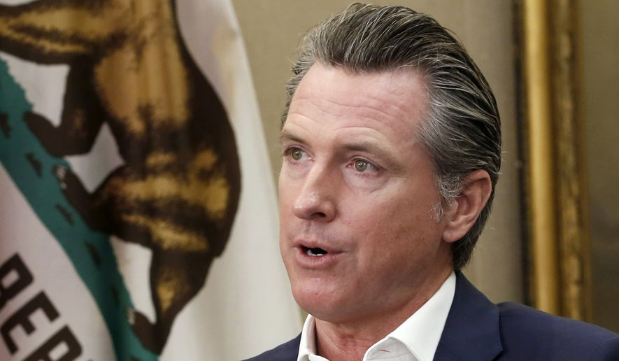 This Oct. 8, 2019, file photo, shows California Gov. Gavin Newsom during an interview in his office at the Capitol in Sacramento, Calif. Pacific Gas & Electric's plan to emerge from bankruptcy faced another threat from Newsom during a Tuesday, Feb. 11, 2020, court hearing that set the stage for a potentially dramatic showdown later this month. Newsom's lawyers told U.S. Bankruptcy Judge Dennis Montali they want to grill PG&E about the company's plans to borrow billions of dollars and sell more stock to help pay the $13.5 billion owed to more than 75,000 victims of catastrophic wildfires ignited by the utility's equipment and negligence. (AP Photo/Rich Pedroncelli, File)