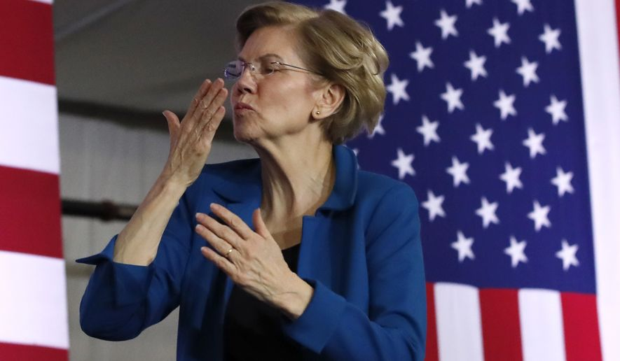 Democratic presidential candidate Sen. Elizabeth Warren, D-Mass., blows a kiss to supporters at a primary election night rally, Tuesday, Feb. 11, 2020, in Manchester, N.H. (AP Photo/Elise Amendola)