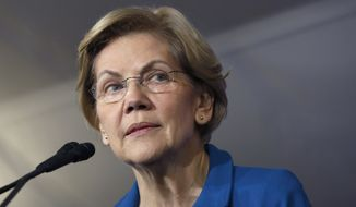 Democratic presidential candidate Sen. Elizabeth Warren, D-Mass., speaks to supporters at a primary election night rally, Tuesday, Feb. 11, 2020, in Manchester, N.H. (AP Photo/Elise Amendola)