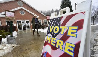 Gina Hammett, of Hinsdale, N.H., leaves the Millstream Community Center, in Hinsdale, after casting her vote in the New Hampshire presidential primary elections, Tuesday, Feb. 11, 2020. (Kristopher Radder/The Brattleboro Reformer via AP)