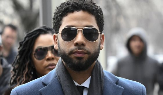 In this March 14, 2019, file photo, Empire actor Jussie Smollett arrives at the Leighton Criminal Court Building for his hearing in Chicago. Smollett faces new charges for reporting an attack that Chicago authorities contend was staged to garner publicity, according to media reports Tuesday, Feb. 11, 2020. The charges include disorderly conduct counts, according to the reports that cite unidentified sources.  (AP Photo/Matt Marton, File) **FILE**