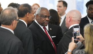Justice Clarence Thomas of the Supreme Court of the United States mingles after delivering a keynote address during a dedication of Georgia's new Nathan Deal Judicial Center, Tuesday, Feb. 11, 2020, in Atlanta. (AP Photo/John Amis)
