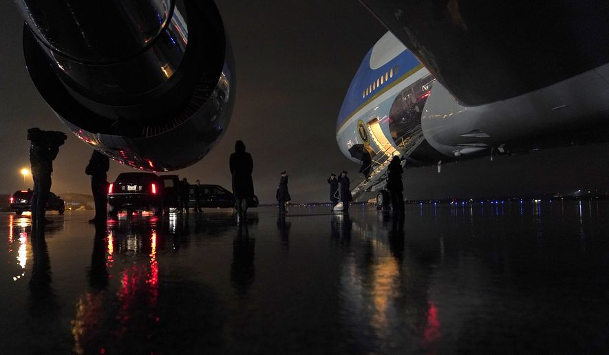 President Donald Trump arrives at Andrews Air Force Base, Md., on Air Force One after attending a campaign rally in New Hampshire and a casualty return for two Army soldiers killed in Afghanistan at Dover Air Force Base, in Delaware, early Tuesday, Feb. 11, 2020. (AP Photo/Evan Vucci)