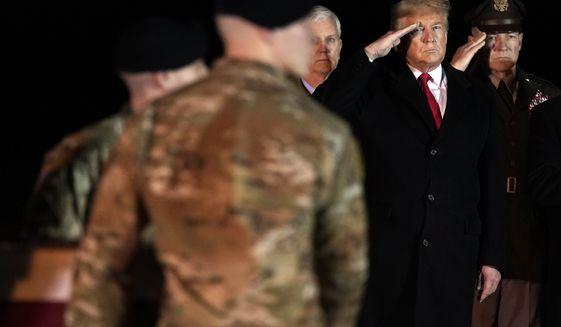 President Donald Trump salutes as a U.S. Army carry team moves a transfer case containing the remains of Sgt. 1st Class Javier Gutierrez, of San Antonio, Texas, Monday, Feb. 10, 2020, at Dover Air Force Base, Del. According to the Department of Defense both Gutierrez and Sgt. 1st Class Antonio Rodriguez, of Las Cruces, N.M., died Saturday, Feb. 8, during combat operations in Afghanistan. (AP Photo/Evan Vucci)