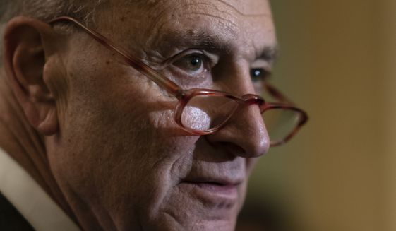 Senate Minority Leader Chuck Schumer, D-N.Y., pauses as he talks to reporters following a Democratic strategy meeting at the Capitol in Washington, Tuesday, Feb. 11, 2020. (AP Photo/J. Scott Applewhite) **FILE**