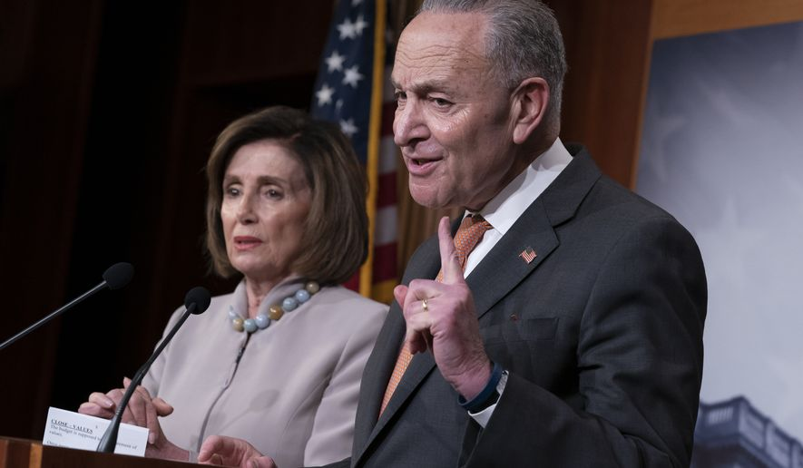 Speaker of the House Nancy Pelosi, D-Calif., left, and Senate Minority Leader Chuck Schumer, D-N.Y., talk to reporters about President Donald Trump's budget request for fiscal year 2021, at the Capitol in Washington, Tuesday, Feb. 11, 2020. (AP Photo/J. Scott Applewhite)