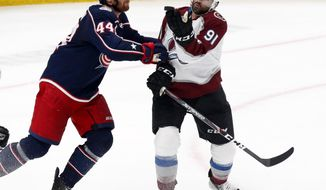 Colorado Avalanche forward Nazem Kadri, right, tries to catch the puck in front of Columbus Blue Jackets defenseman Vladislav Gavrikov, of Russia, during the third period of an NHL hockey game in Columbus, Ohio, Saturday, Feb. 8, 2020. (AP Photo/Paul Vernon)