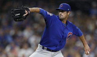 FILE - In this Sept. 11, 2019, file photo, Chicago Cubs pitcher Cole Hamels works against a San Diego Padres batter during the fourth inning of a baseball game in San Diego.  The Atlanta Braves need new veteran leadership for a rotation that has lost Julio Teheran and Dallas Keuchel. Left-hander Cole Hamels is eager to fill the void as pitchers and catchers report to spring training on Wednesday, Feb. 12, 2020. (AP Photo/Gregory Bull, File)