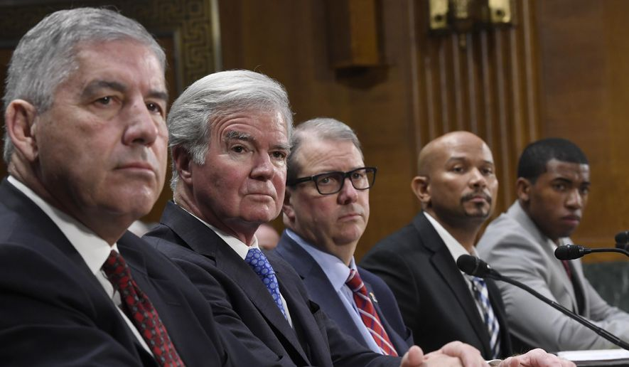 A panel of witnesses, from left, Big 12 Conference Commissioner Bob Bowlsby, National Collegiate Athletic Association President Mark Emmert, University of Kansas Chancellor Dr. Douglas Girod, National College Players Association Executive Director Ramogi Huma, National Collegiate Athletic Association Student-Athlete Advisory Committee Chair Kendall Spencer, listen during a Senate Commerce subcommittee hearing on Capitol Hill in Washington, Tuesday, Feb. 11, 2020, on intercollegiate athlete compensation. (AP Photo/Susan Walsh)