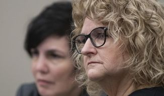 Former Michigan State University women's gymnastics coach Kathie Klages listens to prosecutor's opening statements Tuesday, Feb. 11, 2020, in Ingham County Circuit Court Judge Joyce Draganchuk's courtroom at Veterans Memorial Courthouse in Lansing, Mich.  Klages is charged with lying to investigators in connection with sexual assault complaints against sports doctor Larry Nassar. (Matthew Dae Smith/Lansing State Journal via AP)