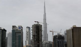 Damac buildings share the skyline in the Business Bay district of Dubai, United Arab Emirates, Tuesday, Feb. 11, 2020. One of Dubai's largest privately-owned developers, DAMAC Properties, is reporting $10 million in net loss last year. The loss comes as Dubai's leadership is beginning to look at ways to curb an oversupply of new properties on the market that's been compounded by an economic slowdown and job losses across the emirate, which is ramping up spending this year to host Expo 2020, the world's fair. (AP Photo/Kamran Jebreili)
