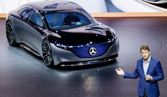 FILE - In this Tuesday, Sept. 10, 2019 file photo Ola Kaellenius, CEO of the car manufacturer Mercedes, stands next to a 'Vision EQS' car at the IAA Auto Show in Frankfurt, Germany. On Tuesday, Feb. 11, 2020 Daimler AG, maker of Mercedes-Benz cars, issues fourth-quarter and full year earnings and provides business update at news conference. (AP Photo/Michael Probst, file)