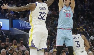 Miami Heat guard Duncan Robinson (55) shoots against Golden State Warriors forward Marquese Chriss (32) during the first half of an NBA basketball game in San Francisco, Monday, Feb. 10, 2020. (AP Photo/Jeff Chiu)