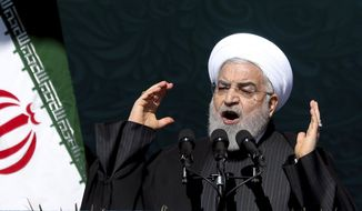 Iranian President Hassan Rouhani speaks during a ceremony celebrating the 41st anniversary of the Islamic Revolution, at the Azadi, Freedom, Square in Tehran, Iran, Tuesday, Feb. 11, 2020. Iranians took to the streets of Tehran and other cities and towns across the country on Tuesday for rallies and nationwide celebrations marking the anniversary of the 1979 Islamic Revolution when followers of Ayatollah Khomeini ousted U.S.-backed Shah Mohammad Reza Pahlavi. (AP Photo/Ebrahim Noroozi)