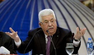 """Palestinian President Mahmoud Abbas speaks after a meeting of the Palestinian leadership in the West Bank city of Ramallah. Tuesday, Jan. 22, 2020. President Abbas said """"a thousand no's"""" Tuesday to the Mideast peace plan announced by President Donald Trump, which strongly favors Israel. (AP Photo/Majdi Mohammed)"""