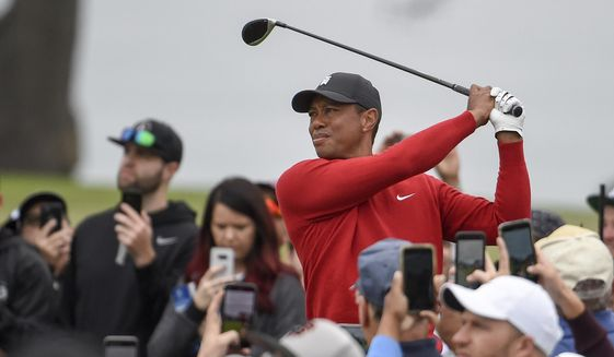 In Jan. 26, 2020, file photo, Tiger Woods watches his tee shot on the second hole of the South Course at Torrey Pines Golf Course during the final round of the Farmers Insurance golf tournament Sunday, in San Diego. Riviera is where Tiger Woods played his first PGA Tour event as an amateur. It would be the ideal place to set the tour record for most wins. (AP Photo/Denis Poroy) ** FILE **