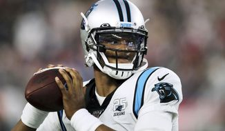 FILE - In this Aug. 22, 2019, file photo, Carolina Panthers quarterback Cam Newton warms up before an NFL preseason football game against the New England Patriots in Foxborough, Mass. While Newton remains optimistic about his chances of playing for the Panthers next season, the team is remaining mostly silent on the quarterback's future. (AP Photo/Charles Krupa, File)
