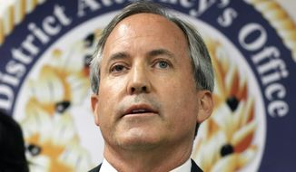 In this June 22, 2017, file photo, Texas Attorney General Ken Paxton speaks at a news conference in Dallas. Paxton on Monday, Feb. 10, 2020, asked the U.S. Supreme Court to overturn a California law that forbids California state employees using taxpayer-funded business trips to expos or conferences in Texas. California adopted the sanctions in response to a 2017 Texas law allowing foster care and adoption agencies to deny services based on religious beliefs. (AP Photo/Tony Gutierrez, File)