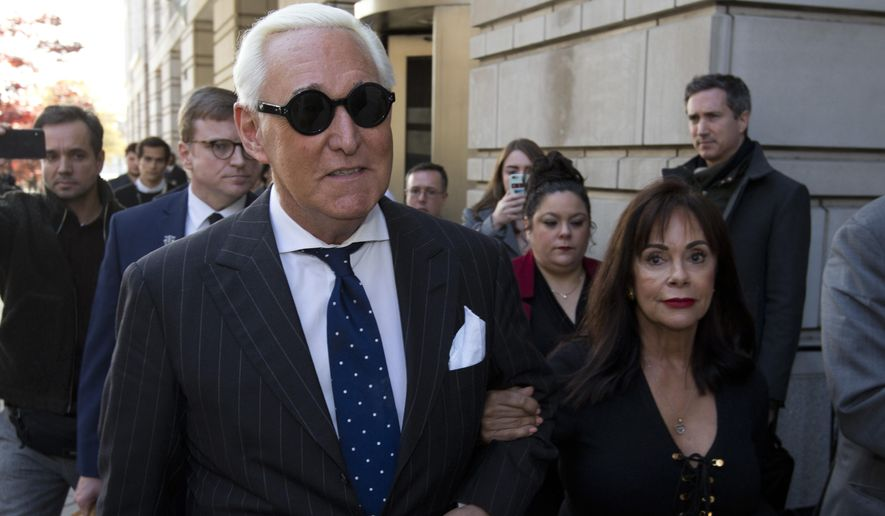 Roger Stone (left), with his wife Nydia Stone, leaves federal court in Washington on Friday, Nov. 15, 2019. (AP Photo/Jose Luis Magana) **FILE**
