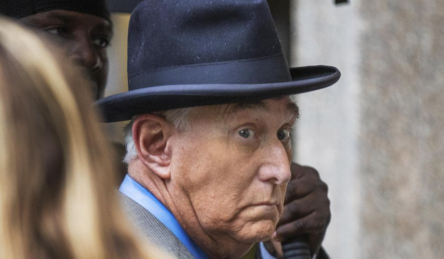 In this Nov. 12, 2019, file photo, Roger Stone, a longtime Republican provocateur and former confidant of President Donald Trump, waits in line at the federal court in Washington. (AP Photo/Manuel Balce Ceneta)  ** FILE **