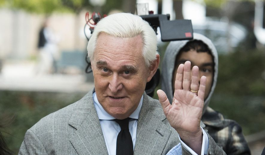 In this Nov. 7, 2019 file photo, Roger Stone arrives at federal court for his federal trial in Washington. (AP Photo/Cliff Owen) ** FILE **