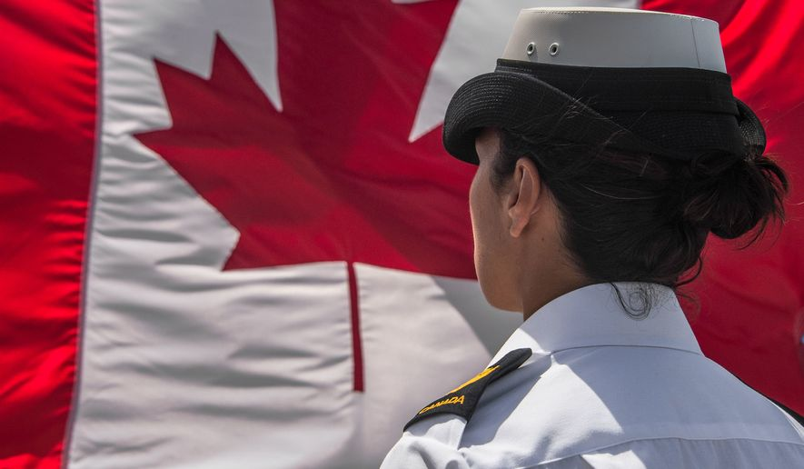 A female Canadian sailor stands at attention during a 2015 inspection. (Source: Canadian Army)