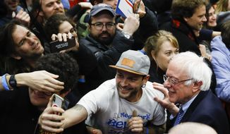 Democratic presidential candidate Sen. Bernie Sanders, I-Vt., greets supporters at a primary night election rally in Manchester, N.H., Tuesday, Feb. 11, 2020. (AP Photo/Matt Rourke) **FILE**
