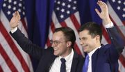 Democratic presidential candidate former South Bend, Ind., Mayor Pete Buttigieg waves with husband Chasten Buttigieg, left, at a primary night election rally in Nashua, N.H., Tuesday, Feb. 11, 2020. (AP Photo/Mary Altaffer)