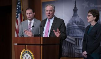 Sen. Tim Kaine, D-Va., center, flanked by Sen. Mike Lee, R-Utah, and Sen. Susan Collins, R-Maine, speaks to reporters just after the Senate advanced a bipartisan resolution asserting that President Donald Trump must seek approval from Congress before engaging in further military action against Iran, at the Capitol in Washington, Wednesday, Feb. 12, 2020. (AP Photo/J. Scott Applewhite)