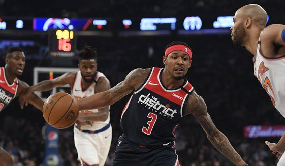 Washington Wizards guard Bradley Beal (3) dribbles the ball as New York Knicks center Taj Gibson (67) defends during the first half of an NBA basketball game, Wednesday, Feb. 12, 2020, in New York. (AP Photo/Sarah Stier)