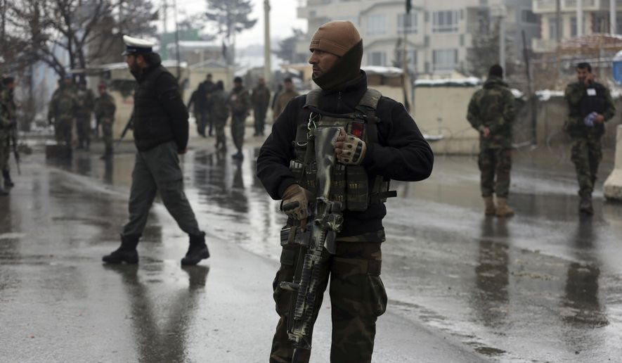National army soldiers stand guard at the site of suicide attack near the military academy in Kabul, Afghanistan, Tuesday, Feb. 11, 2020. A suicide bomber targeting a military academy in the Afghan capital on Tuesday killed at least six people, including two civilians and four military personnel, the Interior Ministry said. (AP Photo/Rahmat Gul)