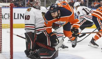 Chicago Blackhawks goalie Robin Lehner (40) is crashed into be Edmonton Oilers' Zack Kassian (44) during the second period of an NHL hockey game in Edmonton, Alberta, Tuesday Feb. 11, 2020. (Jason Franson/The Canadian Press via AP)