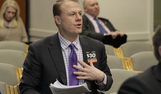 FILE - In this Feb. 4, 2020, file photo, initiative promoter Tim Eyman waits to speak during a hearing before the Washington State Senate Transportation Committee at the Capitol in Olympia, Wash., regarding proposed legislation surrounding I-976, an initiative passed by voters and promoted by Eyman in 2019 that would cut car tab registration fees to $30. A King County Superior Court judge on Wednesday, Feb. 12, 2020, has rejected most of a legal challenge to Eyman's measure, officials say would gut transportation budgets. (AP Photo/Ted S. Warren, File)