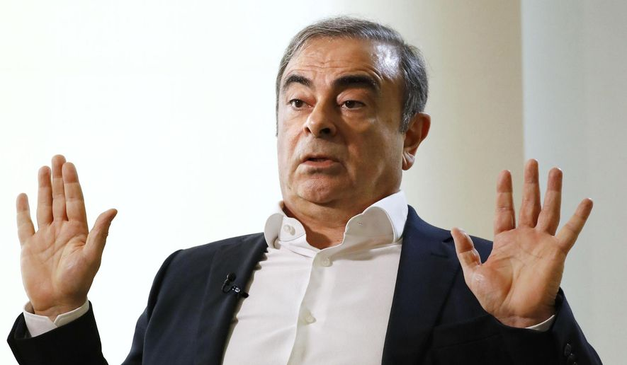 In this  Jan. 10, 2020, file photo, former Nissan Chairman Carlos Ghosn speaks to Japanese media during an interview in Beirut, Lebanon. Nissan filed a civil suit Wednesday, Feb. 12, 2020, seeking 10 billion yen ($91 million) in damages from the Japanese automaker's former Chairman Carlos Ghosn. (Meika Fujio/Kyodo News via AP, File)
