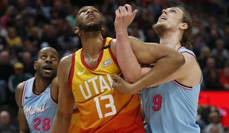Utah Jazz center Tony Bradley (13) and Miami Heat forward Kelly Okynyk (9) battle for position under the boards in the first half of an NBA basketball game Wednesday, Feb. 12, 2020, in Salt Lake City. (AP Photo/Rick Bowmer)