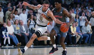 Georgia Tech guard Jordan Usher (4) takes the ball away from Louisville forward Jae'Lyn Withers (3) during the first half of an NCAA college basketball game in Atlanta, Wednesday, Feb. 12, 2020. (AP Photo/Todd Kirkland)