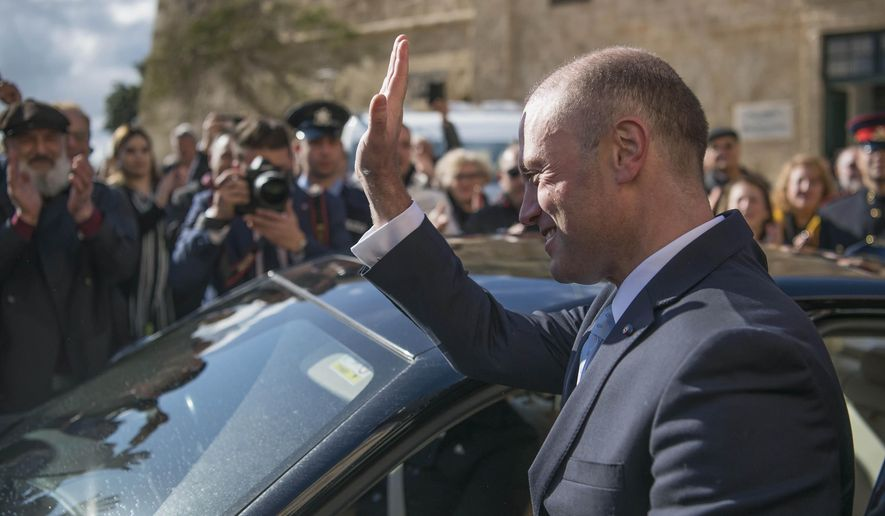 Joseph Muscat leaves his office of Castille for the last time, as he goes to the president with his resignation, in Valletta, Malta, Monday, Jan. 13, 2020. Robert Abela is replacing Muscat as premier after weeks of protests demanding accountability in the investigation of the car bomb slaying of an anti-corruption journalist who targeted his government. (AP Photo/Rene' Rossignaud)