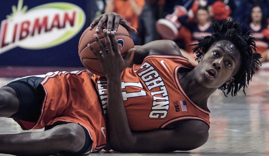 Illinois' Ayo Dosunmu (11) reacts to being called for a foul while attempting to steal the ball against Michigan State in the second half of an NCAA college basketball game Tuesday, Feb. 11, 2020, in Champaign, Ill. (AP Photo/Holly Hart)
