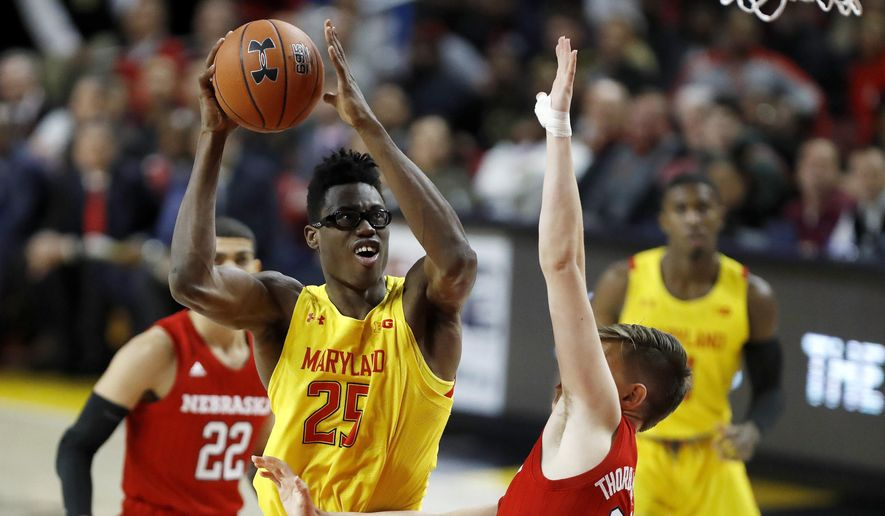 Maryland forward Jalen Smith (25) goes up for a shot against Nebraska guard Thorir Thorbjarnarson (34) during the first half of an NCAA college basketball game, Tuesday, Feb. 11, 2020, in College Park, Md. (AP Photo/Julio Cortez)  **FILE**