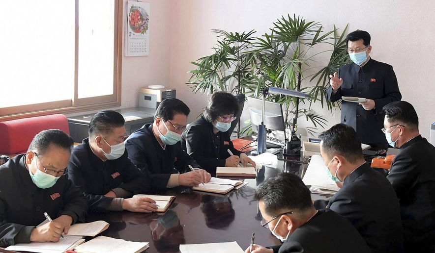 In this undated photo distributed on Wednesday, Feb. 12, 2020, by the North Korean government, North Korean Premier Kim Jae Ryon, right top, has a meeting at the emergency anti-epidemic headquarter in Pyongyang, North Korea. Independent journalists were not given access to cover the event depicted in this image distributed by the North Korean government. The content of this image is as provided and cannot be independently verified. (Korean Central News Agency/Korea News Service via AP)