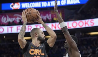 Orlando Magic guard Evan Fournier (10) looks to pass after driving to the basket in front of Detroit Pistons forward Tony Snell, right, during the first half of an NBA basketball game Wednesday, Feb. 12, 2020 in Orlando, Fla. (AP Photo/Phelan M. Ebenhack)