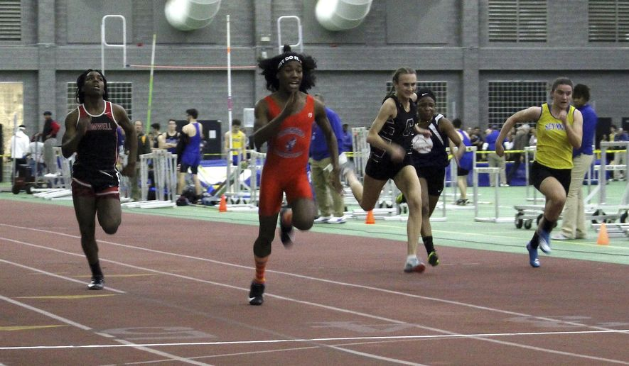 In this Feb. 7, 2019, file photo, Bloomfield High School transgender athlete Terry Miller, second from left, wins the final of the 55-meter dash over transgender athlete Andraya Yearwood, far left, and other runners in the Connecticut girls Class S indoor track meet at Hillhouse High School in New Haven, Conn. Miller and Yearwood are among Connecticut transgender athletes who would be blocked from participating in girls sports under a federal lawsuit filed Wednesday, Feb. 12, 2020, by the families of three athletes. (AP Photo/Pat Eaton-Robb, File)