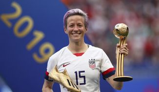 In this Sunday, July 7, 2019 file photo, United States' Megan Rapinoe poses with her individual awards at the end of the Women's World Cup final soccer match between US and The Netherlands at the Stade de Lyon in Decines, outside Lyon, France. The U.S. men's national team urged the U.S. Soccer Federation to sharply increase pay of the American women and accused the governing body of making low-ball offers in negotiations with the men. The union for the women's team filed a gender discrimination lawsuit against the USSF that is scheduled for trial starting May 5. The women agreed to a collective bargaining agreement in April 2017 that extends through 2021. (AP Photo/Francisco Seco, File)