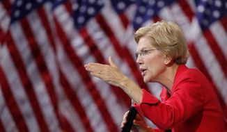 "Sen. Elizabeth Warren said Attorney General William Barr should resign or face impeachment for ""interfering"" with operation of justice. (Associated Press)"